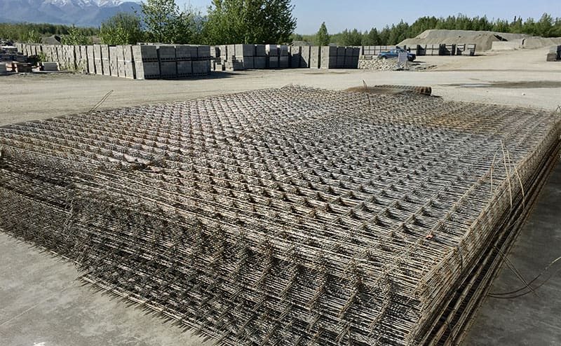 Stacks of sheets of wire mesh.