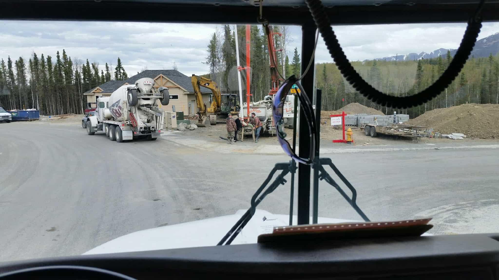 Concrete truck view through the windshield on a job.